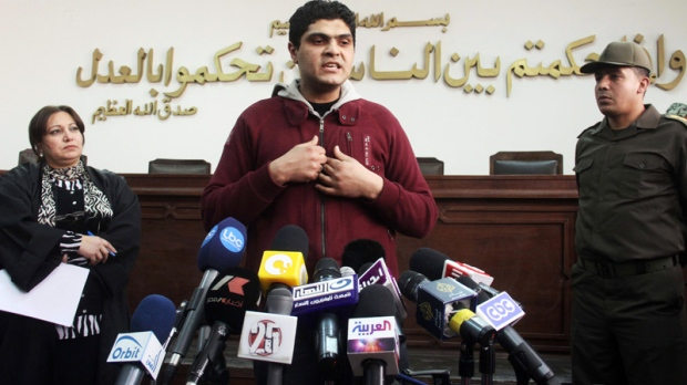 Egyptian Army Dr. Ahmed Adel, who was charged in the forced virginity tests case on Egyptian women protesters last year, speaks during a press conference at a military court in Cairo, Egypt, Sunday, March 11, 2012.