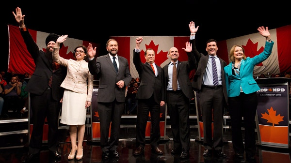 NDP leadership candidates Martin Singh, from left, Niki Ashton, Thomas Mulcair, Brian Topp, Nathan Cullen, Paul Dewar and Peggy Nash pose for a photograph and greet the audience prior a debate in Vancouver, B.C., on Sunday March 11, 2012. (Darryl Dyck / THE CANADIAN PRESS)