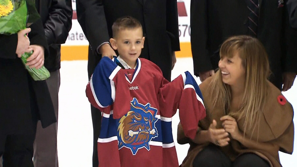 Marcus Cirillo, 5, dropped the puck at a hockey game in Hamilton, Ont., on Sunday, Oct. 26, 2014.