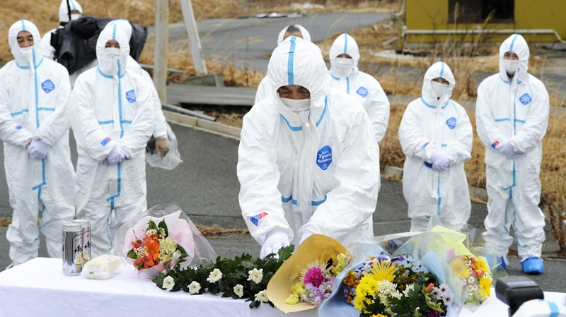 Mourners mark the one-year anniversary of the Fukushima nuclear disaster. (The Associated Press)