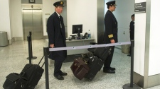 Air Canada pilots head to work as at Pearson International Airport in Toronto on Thursday, March. 8, 2012. (Nathan Denette / THE CANADIAN PRESS)