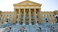 Cyclists ride past the Alberta Legislature in Edmonton, on Saturday, Aug. 30, 2014. (File / THE CANADIAN PRESS)