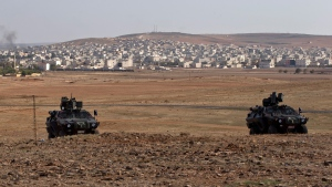 Turkish military vehicles on a hilltop on the outskirts of Suruc, Turkey, on Oct. 26, 2014. (Vadim Ghirda/AP)