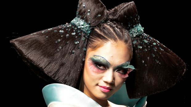A model presents a creation at MGPIN 2015 Mao Geping Makeup Trends Launch collection during the China Fashion Week in Beijing, China Monday, Oct. 27, 2014. (AP / Andy Wong)