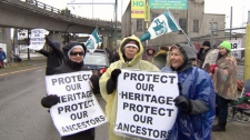 Members and supporters of the Musqueam First Nation gathered in Vancouver to oppose the construction of condos over a sacred grave site. March 12, 2012. (CTV)