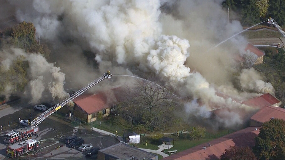 Firefighters battle a blaze at a nursing home in Whitby, Ont., Monday, Oct. 27, 2014.