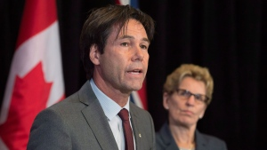 Ontario Health Minister Eric Hoskins is proposing a change that would allow all qualified health-care providers in the province to refer transgender patients for the surgery.  (Frank Gunn / THE CANADIAN PRESS)
