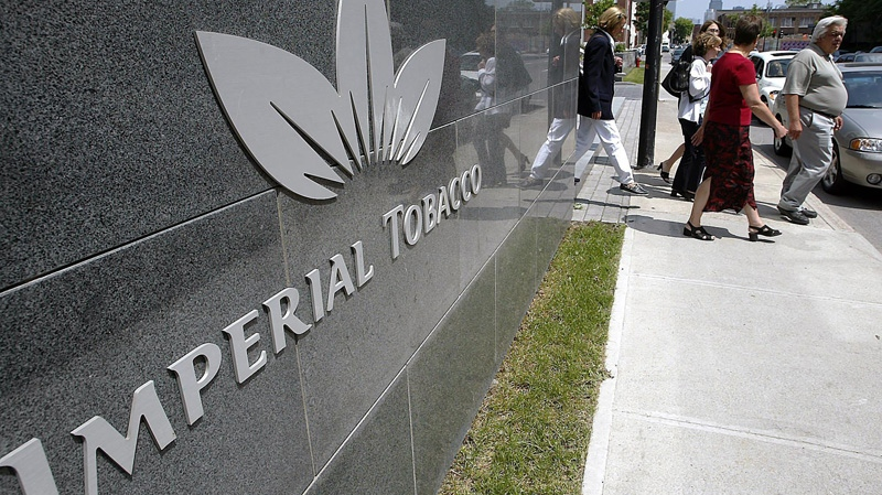 Imperial Tobacco Canada employees leave the production plant for lunch in Montreal, Wednesday, June 18, 2003. (Andre Pichette / THE CANADIAN PRESS)