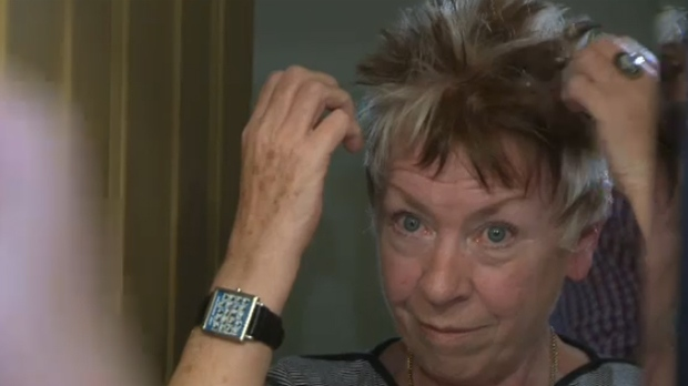 Former WestJet employee Janet Moore attends to her hair, a style which the company had concerns over