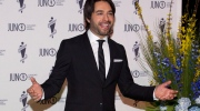 Jian Ghomeshi arrives on the green carpet for the Juno Gala in Winnipeg on Saturday, March 29, 2014. (The Canadian Press/John Woods)
