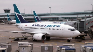 WestJet Airlines Boeing 737 jetliners in Toronto, Ontario on Oct. 13, 2014. (Larry MacDougal / THE CANADIAN PRESS)