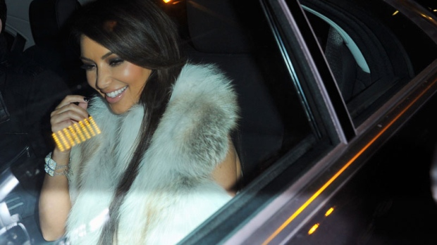 Kim Kardashian arrives to Kanye West presentation for Women's Fall-Winter, ready-to-wear 2013 fashion collection, during Paris Fashion week, Tuesday, March 6, 2012. (AP / Zacharie Scheurer)