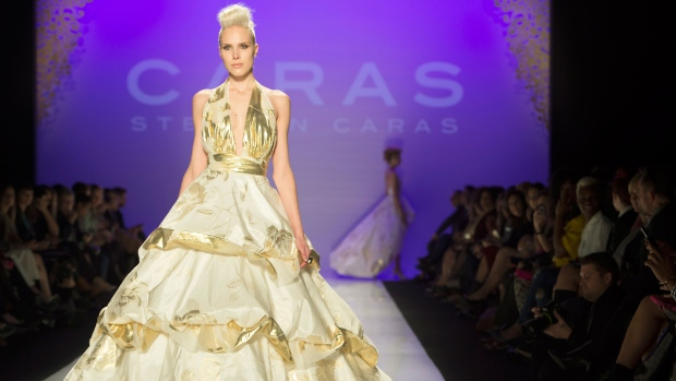 <b>Stephan Caras Collection</b><br><br>A model walks the runway in the Stephan Caras show, part of Fashion Week in Toronto on Friday Oct. 24, 2014. (Frank Gunn / THE CANADIAN PRESS)