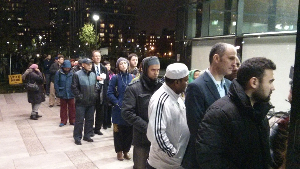 Shortly before polls closed in the municipal election, people were lined up outside a polling station in the Regent Park neighbourhood of Toronto, on Monday, Oct. 27, 2014