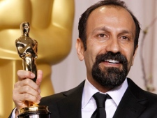 "In this Sunday, Feb. 26, 2012, file photo, Asghar Farhadi poses with the Oscar for best foreign language film for ""A Separation"" during the 84th Academy Awards in the Hollywood section of Los Angeles. (AP Photo/Joel Ryan, File)"