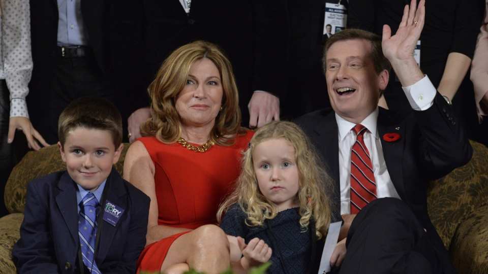 John Tory, back right, his wife Barbara Hackett, back left, and their grandchildren, Jack and Isabel, await the results in the Toronto mayoral election in Toronto on Monday, Oct. 27, 2014. (Nathan Denette / THE CANADIAN PRESS)