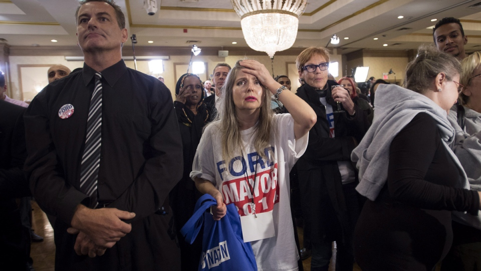 Supporters of mayoral candidate Doug Ford reacts at Ford's election night headquarters prior to the voting polls closing in Toronto on Monday, Oct. 27, 2014. (Darren Calabrese / THE CANADIAN PRESS)