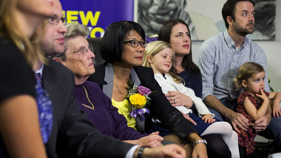 Toronto mayoral candidate Olivia Chow watches municipal election results with family in Toronto on Monday, Oct. 27, 2014. (Michelle Siu / THE CANADIAN PRESS)