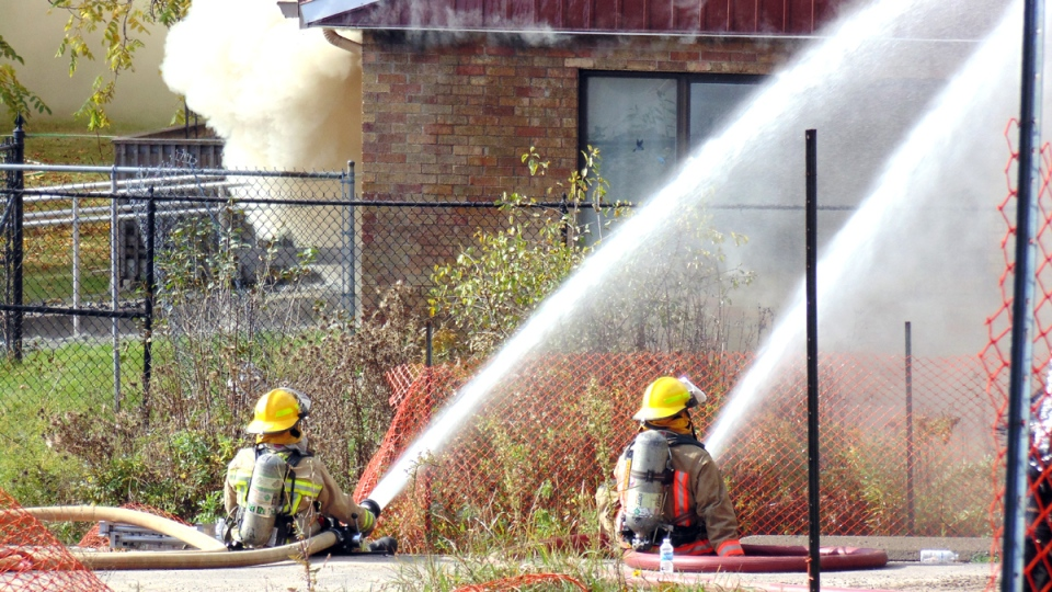 Firefighters work to extinguish a fire at Fairview Lodge in Whitby, Ont., Monday, Oct. 27, 2014. (Jim Miller / MyNews)
