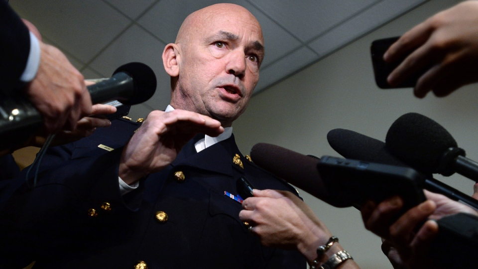 RCMP Commissioner Bob Paulson speaks to media after appearing at Senate National Security and Defence committee in Ottawa on Monday, Oct. 27, 2014. (Sean Kilpatrick / THE CANADIAN PRESS)