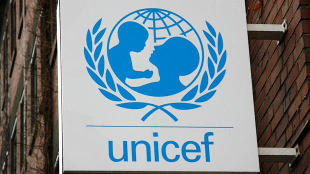 The UNICEF logo is fixed at the German UNICEF headquarters in Cologne, Germany, on Feb. 5, 2008. (AP Photo/Hermann J. Knippertz, File)