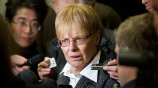Plaintiff Cecilia Letourneau speaks to reporters at the Montreal courthouse, Monday, March 12, 2012 on the opening day of a massive lawsuit against the tobacco industry. (Graham Hughes / THE CANADIAN PRESS)