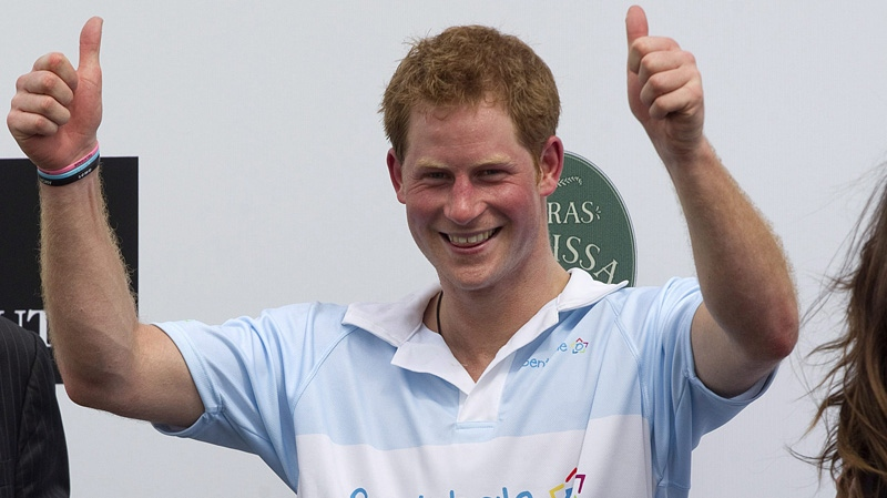 Britain's Prince Harry gives a thumbs up during the award ceremony after playing a charity polo match in Campinas, Brazil, Sunday March 11, 2012. (AP Photo/Andre Penner)