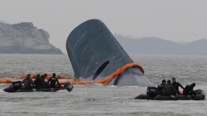 South Korean Coast Guard officers search the sunken ferry Sewol near Jindo, South Korea, on April 17, 2014. (AP / Ahn Young-joon)