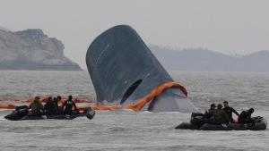 South Korean Coast Guard officers search the sunken ferry Sewol near Jindo, South Korea, on April 17, 2014. (AP / Ahn Young-joon)