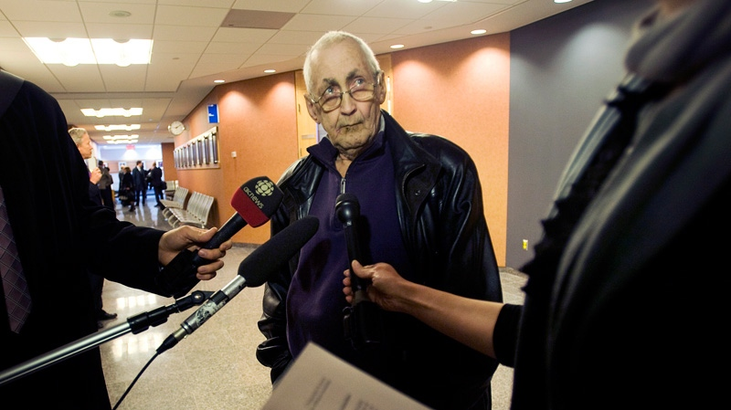 Plaintiff Jean Yves Blais speaks to reporters at the Montreal courthouse, Monday, March 12, 2012 on day one of a massive lawsuit against the tobacco industry. (Graham Hughes / THE CANADIAN PRESS)