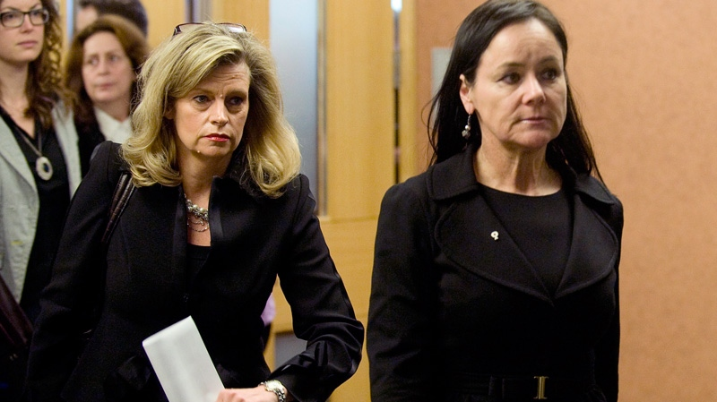 Deborah Glendinning, left, and Suzanne Cote, lawyers representing Imperial Tobacco, are shown at the Montreal courthouse, Monday, March 12, 2012 on the opening day of a massive lawsuit against the tobacco industry. (Graham Hughes / THE CANADIAN PRESS)