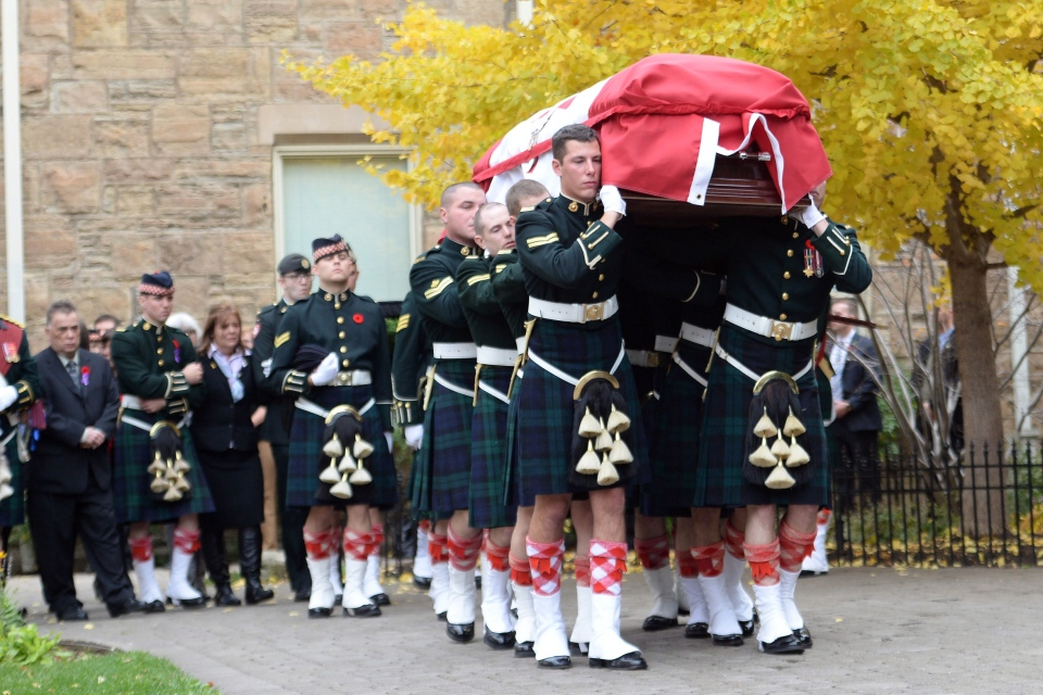 The coffin of Cpl. Nathan Cirillo is carried by pallbearers at his regimental funeral service in Hamilton, Ont., on Tuesday, Oct. 28, 2014. (Nathan Denette / THE CANADIAN PRESS)