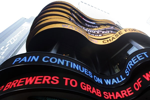 The day's financial news is displayed on the ABC news ticker in New York's Times Square, Monday, Sept. 15, 2008. (AP / Mary Altaffer)