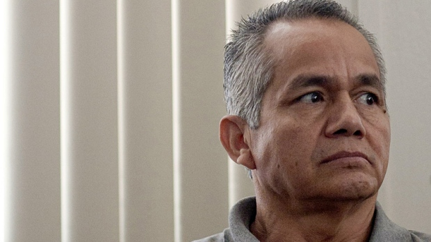 "Pedro Pimentel Rios, a former member of an elite Guatemalan military force known as the ""kaibiles,"" attends his trial at a court in Guatemala City, Monday March 12, 2012. (AP Photo/Moises Castillo)"