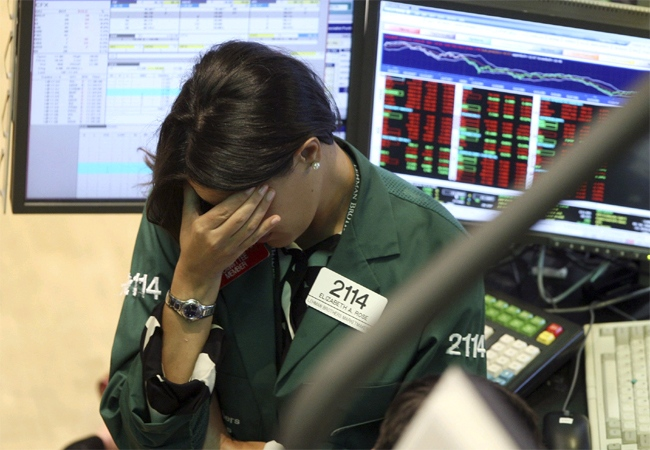 Elizabeth Rose, a specialist with Lehman Brothers MarketMakers, works her post on the trading floor of the New York Stock Exchange, Monday, Sept. 15, 2008.  (AP / David Karp