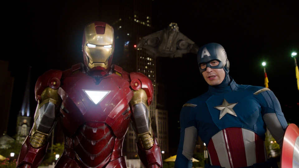 """This film image released by Disney shows, Iron Man, portrayed by Robert Downey Jr., left, and Captain America, portrayed by Chris Evans, in a scene from """"The Avengers."""" Oct. 28, 2014, at the El Capitan Theatre in Hollywood. (AP / Disney)"""