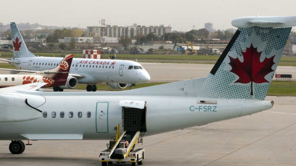 Air Canada planes land at Pierre Elliott Trudeau Airport, in Montreal on Wednesday, Oct. 12, 2011. (Ryan Remiorz / THE CANADIAN PRESS)