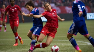 Team Canada's Emily Zurrer fights for control of the ball during first half International friendly soccer action in Vancouver on Oct. 28, 2014. (Jonathan Hayward / THE CANADIAN PRESS)