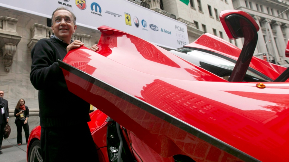 Fiat Chrysler Automobiles CEO Sergio Marchionne, closes the door of a Ferrari LaFerrari, outside the New York Stock Exchange, after he rang the closing bell, Monday, Oct. 13, 2014. (AP / Richard Drew)