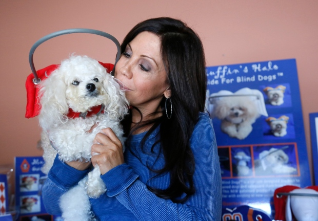 Silvie Bordeaux holds her blind dog Muffin