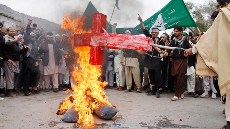 Afghans burn an effigy depicting U.S. President Barack Obama following Sunday's killing of civilians in Panjwai, Kandahar by a U.S. soldier during a protest in Jalalabad east of Kabul, Afghanistan, Tuesday, March 13, 2012. (AP / Rahmat Gul)