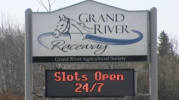 A sign advertising the slots at Grand River Raceway is seen in Elora, Ont. on Wednesday, March 14, 2012.