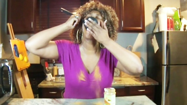 GloZell seemed to be confused about how big a spoon she should use and attempted to swallow a soup ladle-full of cinnamon; it doesn't go well.