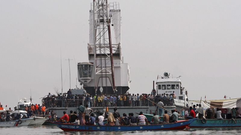 Rescuers search for victims of a ferry accident on the Meghna River in Munshiganj district, about 32 kilometres south of Dhaka, India, Tuesday, March 13, 2012. (AP Photo/Pavel Rahman)