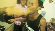 Image from a YouTube video of a man developing 'dragon's breath' while attempting the 'cinnamon challenge.'