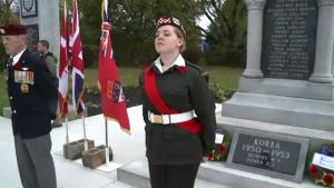 Cadet Ceilidh Bond, 15, stands guard at the cenotaph in Sydney, N.S.