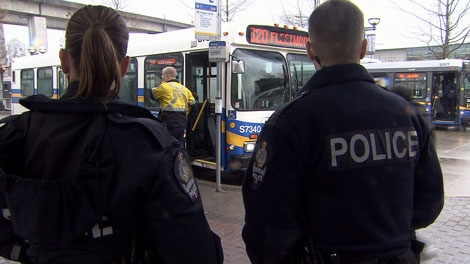 Transit Police officers survey the scene at a SkyTrain station. March 14, 2012. (CTV)