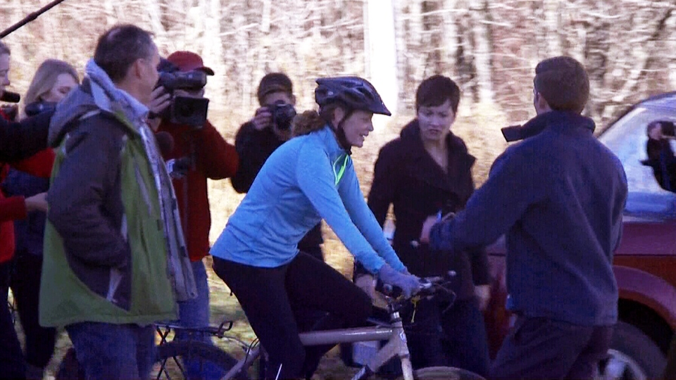 Kaci Hickox is seen going for a bike ride near her home in Fort Kent, Maine, Thursday, Oct. 30, 2014.