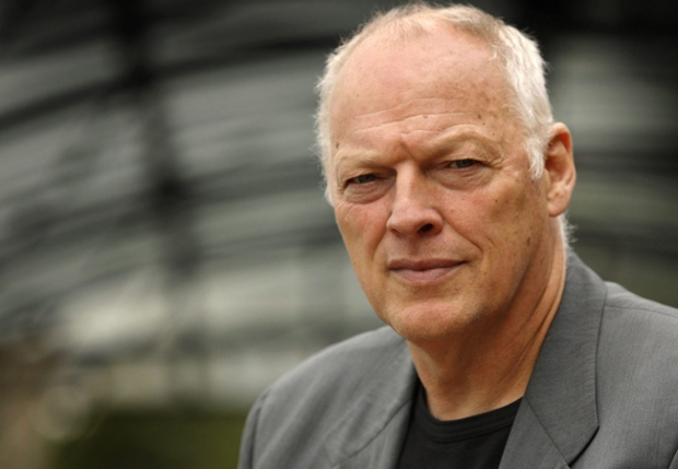 Former British Pink Floyd band member David Gilmour poses aboard his studio boat the 'Astoria' on the River Thames in London, on Wednesday, Aug. 13, 2008. (AP / Joel Ryan)