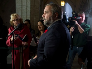NDP leader Tom Mulcair speaks with reporters following question period in the House of Commons Thursday, October 30, 2014 in Ottawa. (Adrian Wyld / THE CANADIAN PRESS)